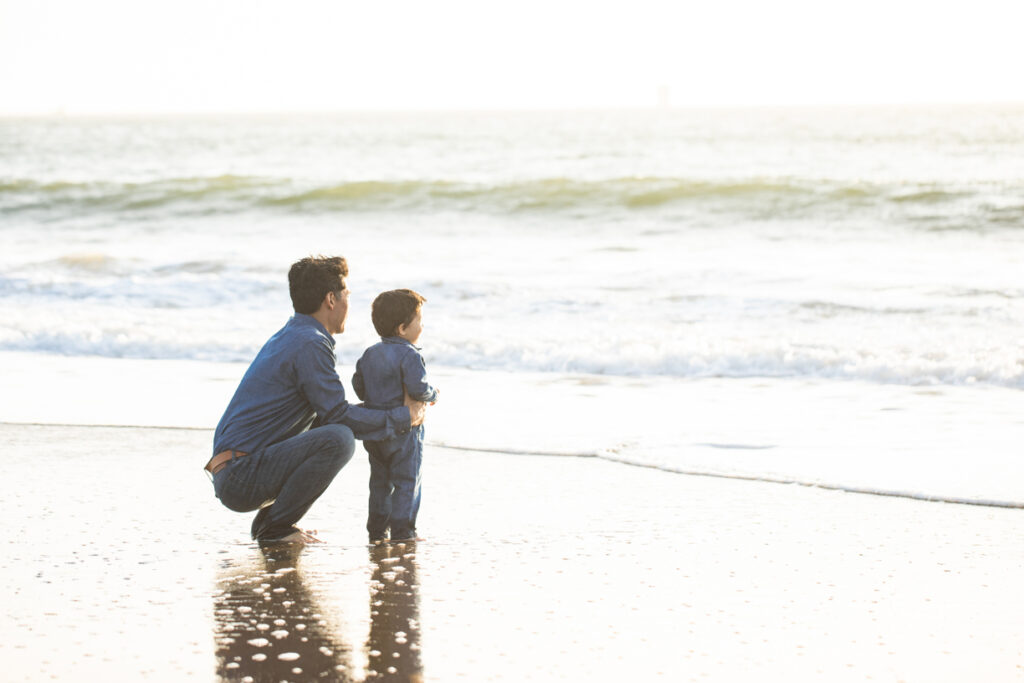 bay and his dad watching the waves